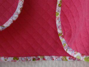gilet rose bordé de biais