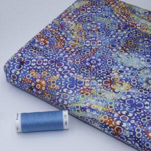 tissu batik feu Perle d'eau bleu (x10cm)