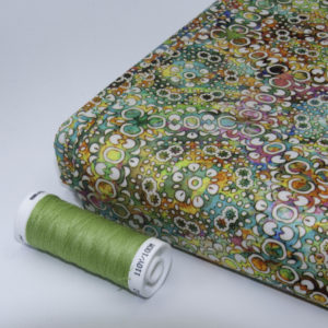 tissu batik feu Perle d'eau vert (x10cm)