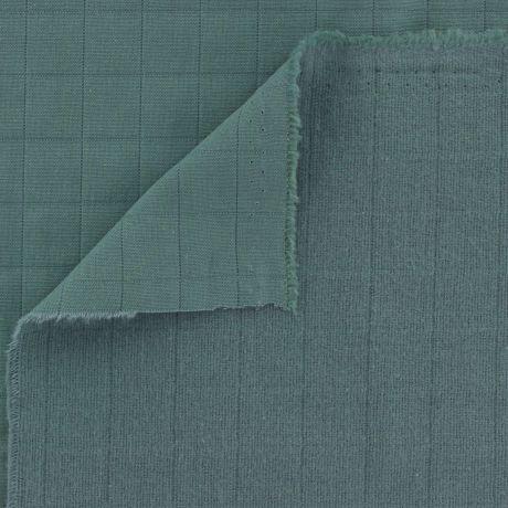 Tissu coton matelassé vert plié