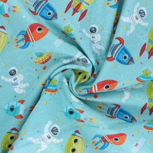 Tissu coton Outer Space Scene fond bleu céladon (x10cm)